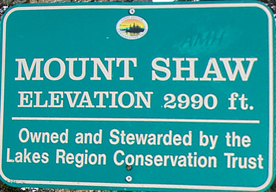 hike mount shaw elevation 2990 feet lakes region conservation trust castle in the clouds trail sign summit